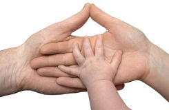 Baby's hand holding the hands of parents isolated Stock Photography