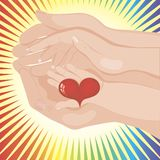 Baby's hand holding a heart between parents' Stock Photography