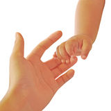 Baby's hand holding mother's finger Stock Photo