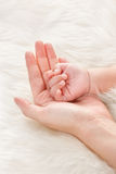 Baby's hand on mother's palm Royalty Free Stock Images