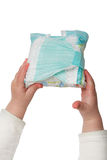 Baby's hands hold dirty diapers Royalty Free Stock Photos