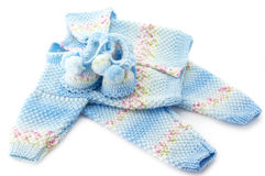 Baby's knitted clothes. Handmade baby's knitted clothes isolated on white background Stock Photo