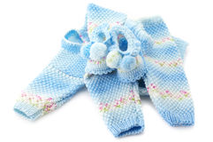 Baby's knitted clothes. Handmade baby's knitted clothes  on white background Royalty Free Stock Photos