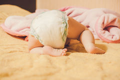 Baby's legs. child hid. Child hid under the blanket royalty free stock photos