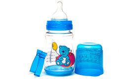 A baby's pacifier. On blue bottle stock images