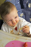 Baby's pasta. A baby is eating pasta stock images