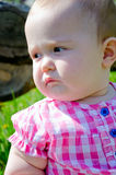 Baby's portrait. Portrait of a beautiful little girl in a pink shirt royalty free stock images