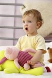 Baby's reaction. A baby is watching TV with close attention stock photography