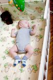 Baby`s restful sleep. Newborn baby in a wooden crib. The baby sleeps in the bedside cradle. Safe living together in a bedside cot royalty free stock images