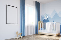 Baby`s room with a crib and a poster Royalty Free Stock Images