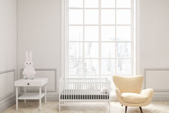 Baby`s room with a large window. Front view of a baby`s room interior with a cradle, an armchair and a bedside table. There is a large window with a cityscape Stock Photos