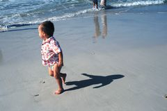 Baby's Shadow on Beach stock images