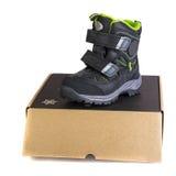 Baby's shoe on the box Stock Photos