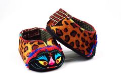 Baby's shoes with tiger head Stock Photos