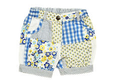 Baby's shorts. Baby girl's shorts on over the white background Royalty Free Stock Images