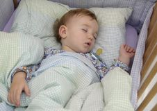 Baby's sleep. A baby is sleeping at the morning royalty free stock photo