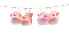 Baby's slippers Stock Photos
