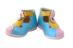 Baby's summer leather boots. Coloured in bright colours - pink, blue and yellow royalty free stock photo