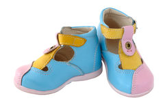 Baby's summer leather boots. Coloured in bright colours - pink, blue and yellow royalty free stock images