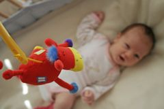 Baby's toy. A baby is looking a toy stock image