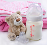 Baby's toy and bottle Royalty Free Stock Images