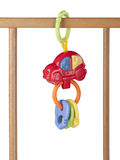 Baby's toy hanging on a cot isolated on white background Royalty Free Stock Photography