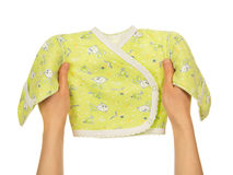 Baby's undershirt in the female hands Stock Photo