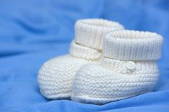 Baby's white bootees Stock Images