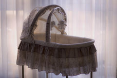 Baby's White and Brown Cradle Stock Photo