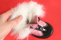 Baby`s winter boot. In women's hand Royalty Free Stock Image