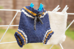 Baby`s woollen pants airing Royalty Free Stock Photos