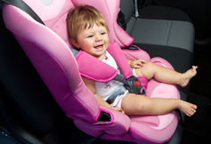 Baby in a safety car seat. Stock Image