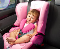 Baby in a safety car seat. Safety and security Royalty Free Stock Photography