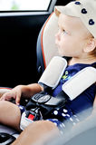 Baby in a safety car seat Stock Image