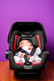 Baby in safety car seat Royalty Free Stock Image