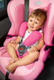 Baby in a safety car seat. Safety and security Royalty Free Stock Photo