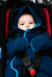 Baby in safety car seat Stock Images