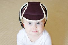 Baby in safety helmet. Baby age of 8 months in safety helmet Royalty Free Stock Photography