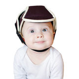 Baby in safety helmet. Baby age of 8 months in safety helmet isolated on white background Royalty Free Stock Photo