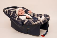 Baby in safety seat Stock Images