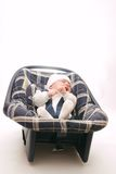 Baby in safety seat. Little baby in safety seat on light background Royalty Free Stock Photos