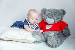 Baby sailor on the pillow with teddy bear Stock Images