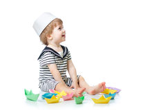 Baby sailor playing with paper boats Stock Photo