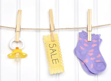 Baby Sale Goods on a Clothesline Stock Images