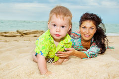 Baby in sand. Baby boy playing in sand with parents Royalty Free Stock Photos