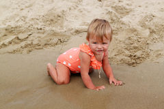 Baby on a sand beach Royalty Free Stock Image