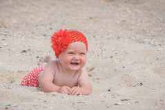 Baby on a sand. Cure baby laying on the sand beach of Black sea Stock Photos