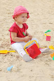 Baby in sand Stock Photography