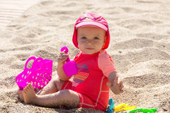 Baby in the sand Stock Image