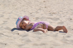 Baby in the sand Royalty Free Stock Photo